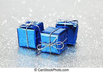 Christmas gifts - Blue Christmas gift boxes on shiny silver...