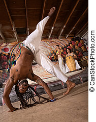 Capoeira Cartwheel - Capoeira man performing a cartwheel...