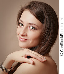 Beautiful natural woman looking with smile Closeup portrait