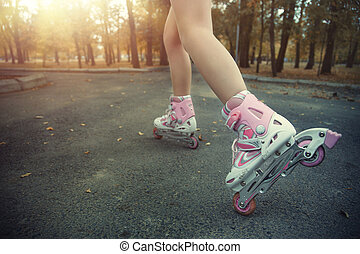 Roller skating - Legs of teenager having roller skate...