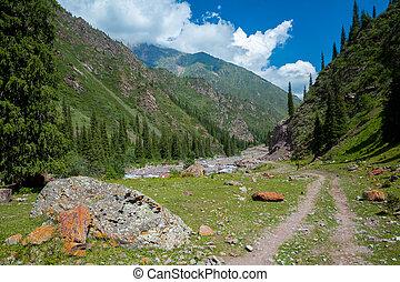 Dirt road in Tien Shan mountains, Kyrgyzstan - Dirt road in...