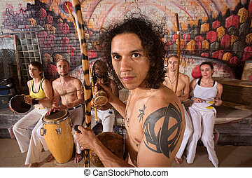 Capoeira Performers Playing Music - Handsome Latino capoeira...