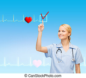 smiling doctor or nurse pointing to something - healthcare,...