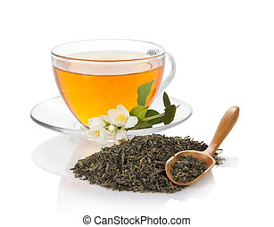 Cup of tea with a jasmine, a wooden spoon with the dry green...