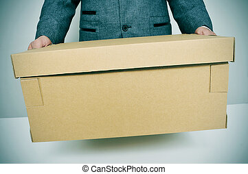 businessman moving office - a businessman carrying a box,...