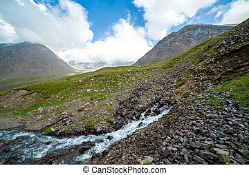 Stream flowing from the rock, Tien Shan, Kyrgyzstan