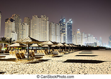 Beach night illumination of the luxury hotel, Dubai, UAE