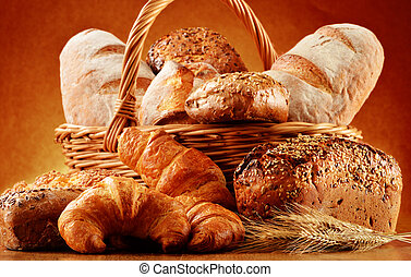 Wicker basket with bread and rolls