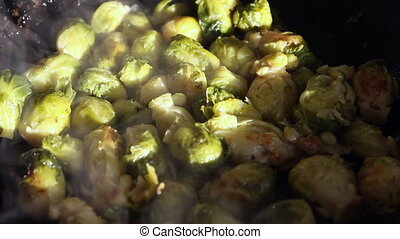 Fried brussels sprouts on a frying-pan