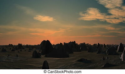 Sunrise in the desert - The desert is dotted with rocks....