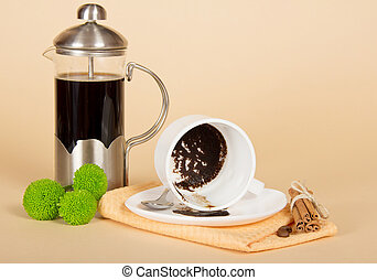 Coffee pot, the overturned cup, cinnamon, spoon,...