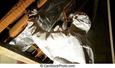 insulation - a man placing insulation mineral wool on the...