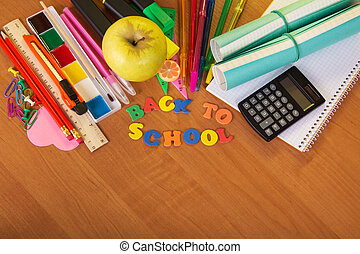 Back to school with pencils - A roll of exercise books, a...