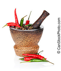 Mortar and pestle with red hot chili pepper and peppercorn....