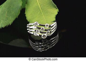wedding ring - diamond wedding ring reflecting on background