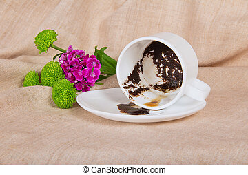 Coffee thick, in the overturned cup, a branch chrysanthemum...