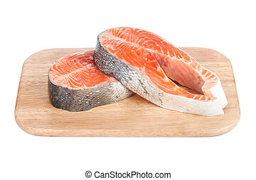 Salmon steaks on cutting board. Isolated on white background
