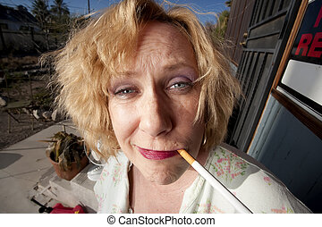 Smoking woman on her porch - Woman with cigarette on her...