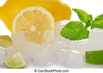 Close-up lemon slice, mint and ice - Juicy ripe lemon, mint...