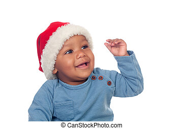 Adorable african baby with Christmas hat isolated on a white...