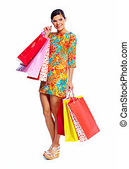 Happy shopping girl with bags. Isolated  white background.