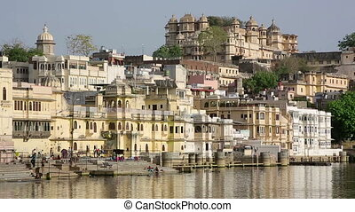 People washing in river, Udaipur - Everyday scene with...