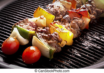 Grilling skewers barbecue with meat and vegetables on...