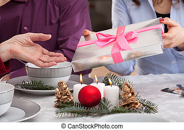 Presents giving during christmas eve - Giving a present for...