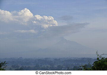 Morning Fog and Active Volcano in Java, Indonesia