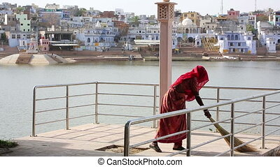 Woman swiping jetty, Pushkar, India - Woman swiping jetty,...