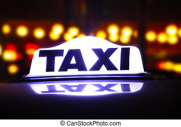 taxi sign illuminated at night