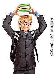 stack books - Portrait of a happy schoolboy in glasses...