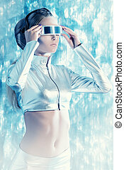 internet technology - Beautiful young woman in silver latex...