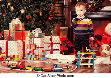 happy childhood - Little boy playing with toys at home near...