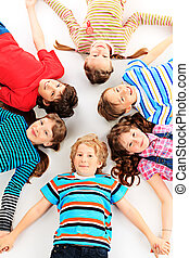 education children - Group of cheerful children lying on a...