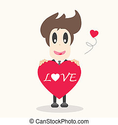 Businessman holding a red heart