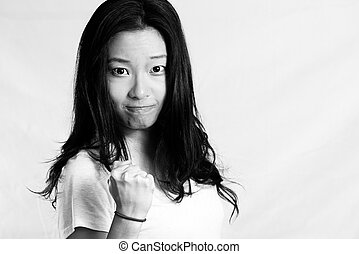 Young woman clenching her fist - Portrait of attractive...