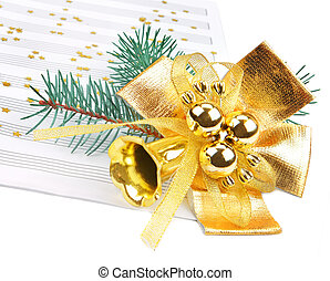 Christmas decorations and music sheet isolated on white...
