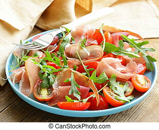 salad with parma ham jamon, tomatoes and arugula