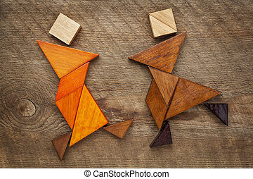 dancing tangram figures - a couple of dancers or martial...