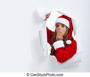 Surprised Santa girl looking through hole in paper - with...