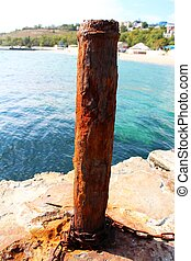 Rusty mooring capstan on a pier - A photo of Rusty mooring...