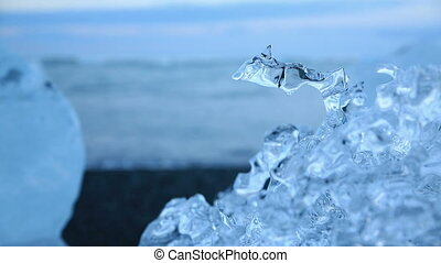 Water drop in blue icebergs and beach - Water droplet...