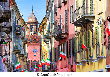 Old historic houses in Alba, Italy - Ancient tower over...
