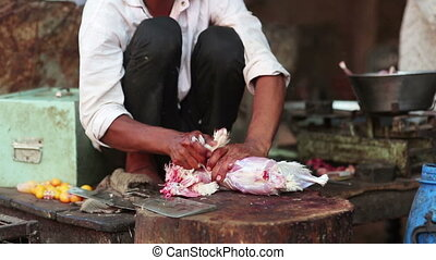Man skinning chicken meat - Man skinning chicken in the...