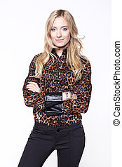 Beautiful blond woman in an brown animal print blouse
