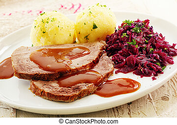 Sliced roast cap of rump topped with a rich brown gravy and...