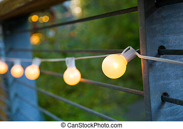 Wedding Decor Lights - Lights are strung up and hung for...