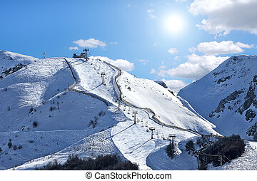 Mountains covered with snow under blue sky - Mountains...