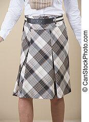 Closeup of womens skirt on biege background - Closeup detail...